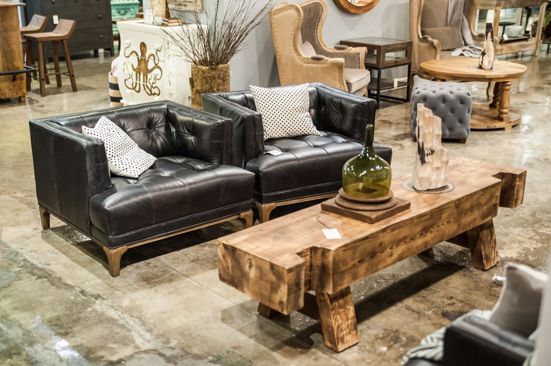 Leather Tufted chairs and wood coffee table in Adjectives Altamonte