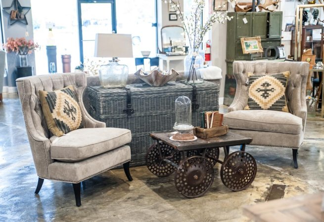 Upholstered high-back chairs and Railroad Cart Coffee Table in Adjectives Altamonte