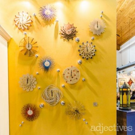 Funky clocks make interesting wall art at Adjectives Market